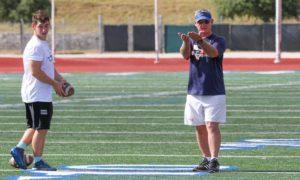 football coach teaching a technique